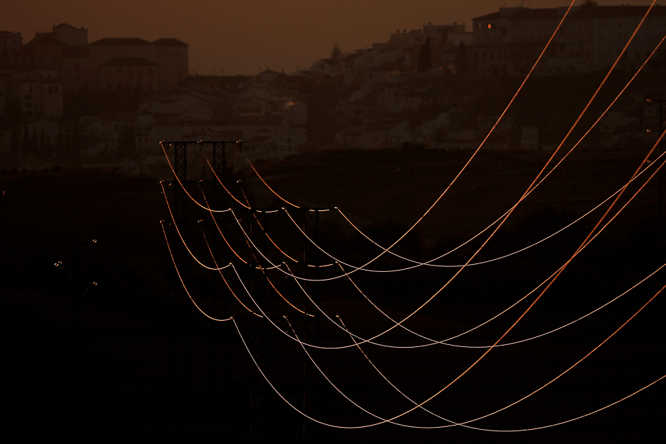 Power lines connecting pylons of high-tension electricity are seen at an electricity substation in the outskirts of Ronda, near Malaga, Spain. PHOTO: REUTERS