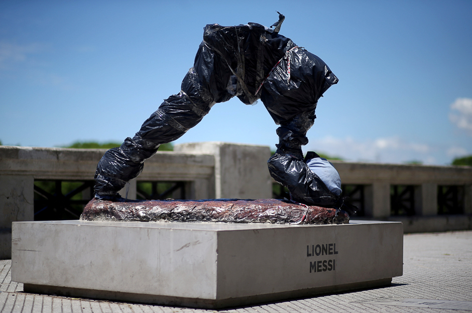 The statue of Argentina's soccer player Lionel Messi is seen covered after it was vandalised in Buenos Aires, Argentina. PHOTO: REUTERS