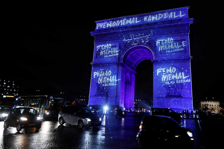 The Arc de Triomphe (Arch of Triumph) is illuminated in Paris, to launch the 25th World Men's Handball Championship. PHOTO: AFP