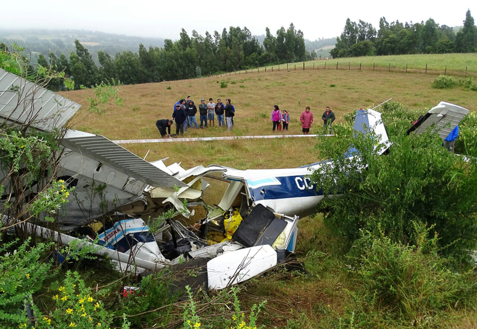 A light aircraft is seen after crashing on the outskirts of Tirua city, south of Chile, killing 4 people onboard, according to local media reports. PHOTO: REUTERS