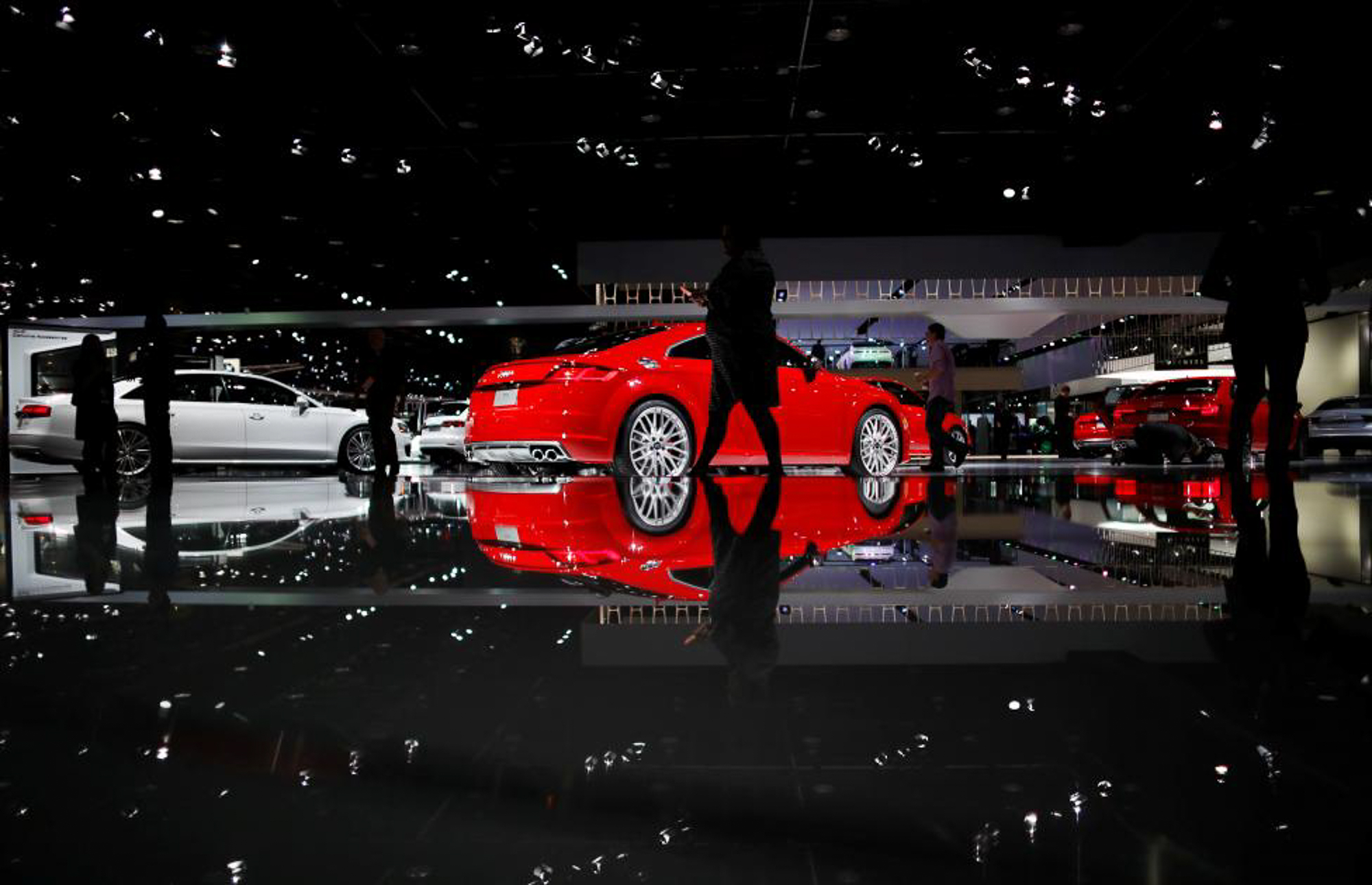 People walk by the Audi display. PHOTO: REUTERS