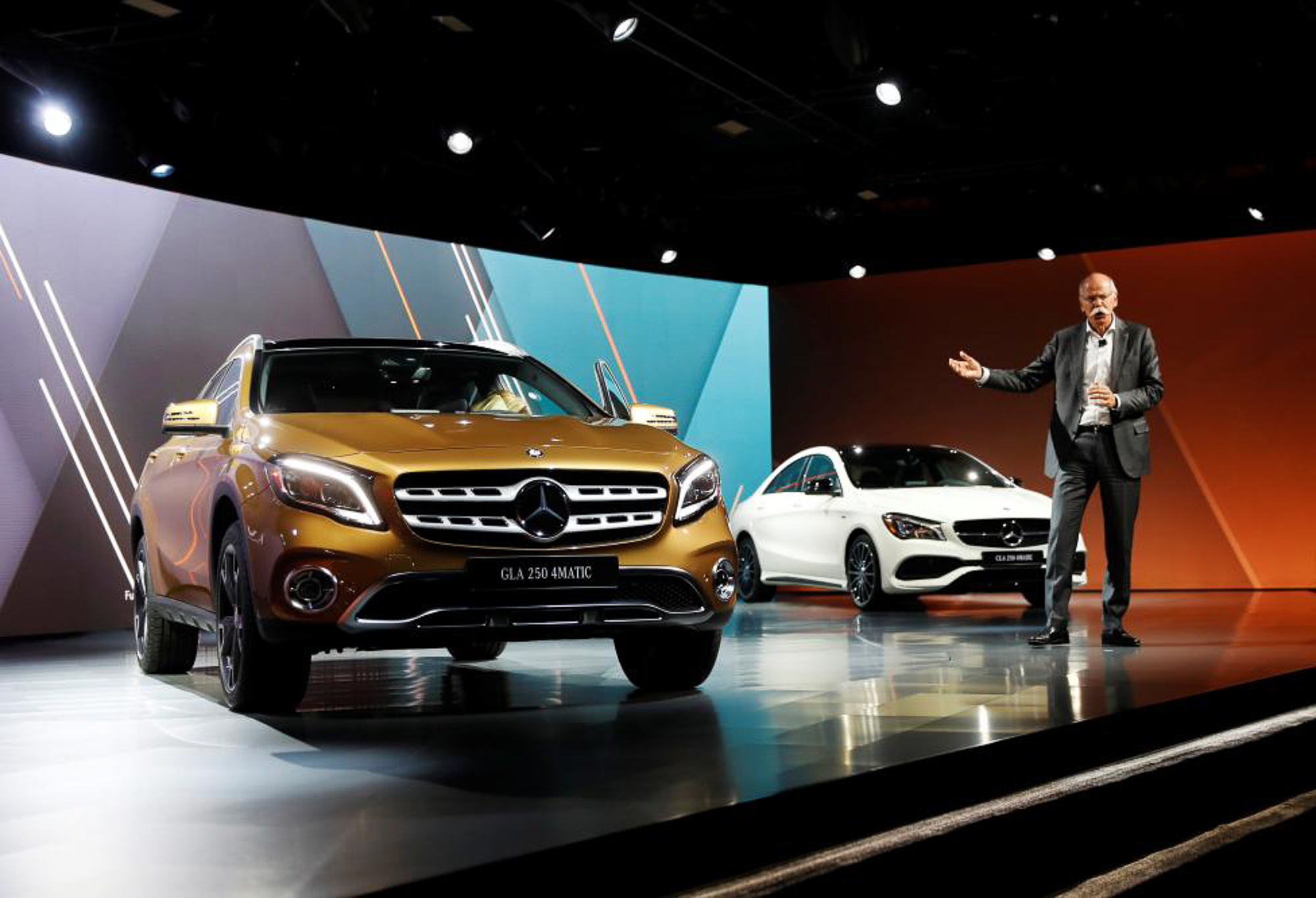 Chairman of the Board of Directors of Daimler AG Dieter Zetsche speaks in front of the revealed Mercedes-Benz GLA 250. PHOTO: REUTERS