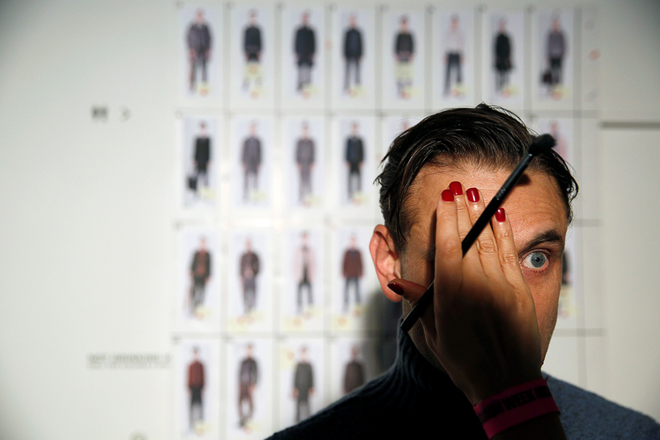 A model is groomed backstage of the Oliver Spencer catwalk show during London Fashion Week Men's 2017 in London, Britain. PHOTO: REUTERS