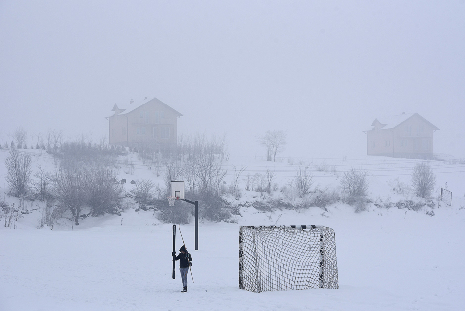 A child walks on a soccer field covered with snow near the village of Kllokot. PHOTO: AFP