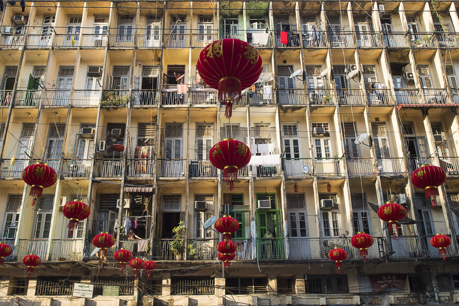 Decorative lanterns are seen hung past residential flats ahead of the Chinese Lunar New Year in Yangon's Chinatown district. PHOTO: AFP