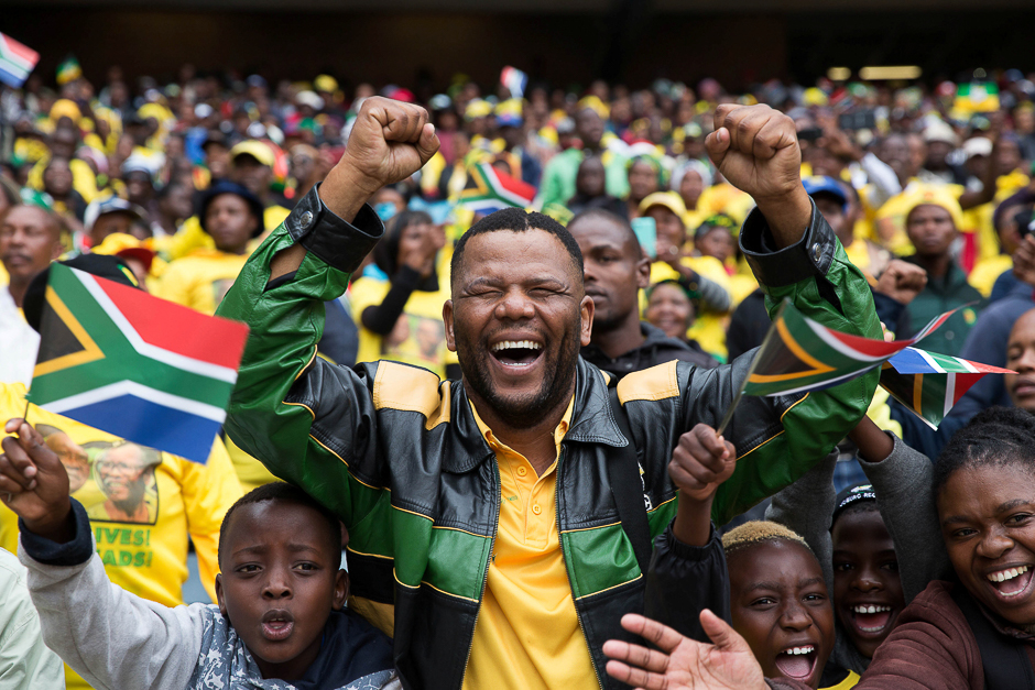 Crowd cheers at a rally to commemorate the 105th birthday of the ruling party African National Congress (ANC) of South African President Jacob Zuma in Soweto, South Africa. PHOTO: REUTERS