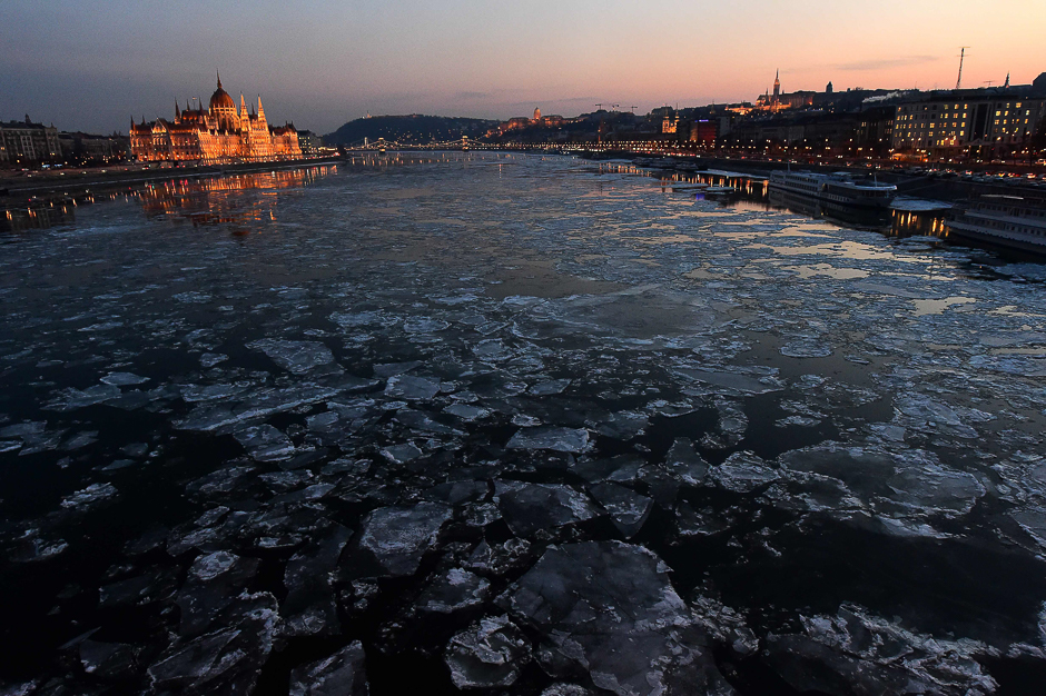 Ice floes float in the water of the River Danube nearby the parliament building (L) of Budapest. PHOTO: AFP
