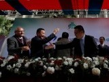 file-photo-nadeem-naqvi-managing-director-of-the-pakistan-stock-exchange-shakes-hands-with-chinese-officials-after-signing-an-agreement-for-a-chinese-led-consortium-to-buy-a-strategic-stake-in-psx