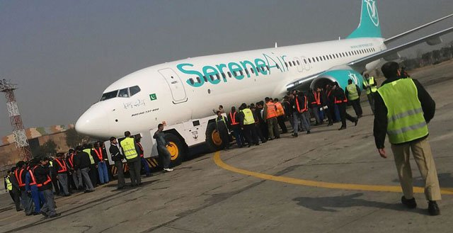The Serene Air jet is being pulled by the tug machine at Islamabad airport. PHOTO: INP