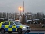 A police passes next to a Pakistan International Airlines aircraft that was intercepted and escorted by fighter jets to Stansted airport northeast of London because of a disruptive passenger, Britain's police said, February 7, 2017. PHOTO: REUTERS