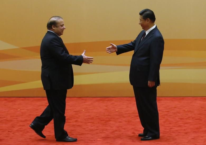 China's President Xi Jinping (R) shakes hands with Pakistan's Prime Minister Nawaz Sharif at their family photo session prior to the Dialogue On Strengthening Connectivity Partnership at the Diaoyutai State Guesthouse in Beijing November 8, 2014. PHOTO: REUTERS