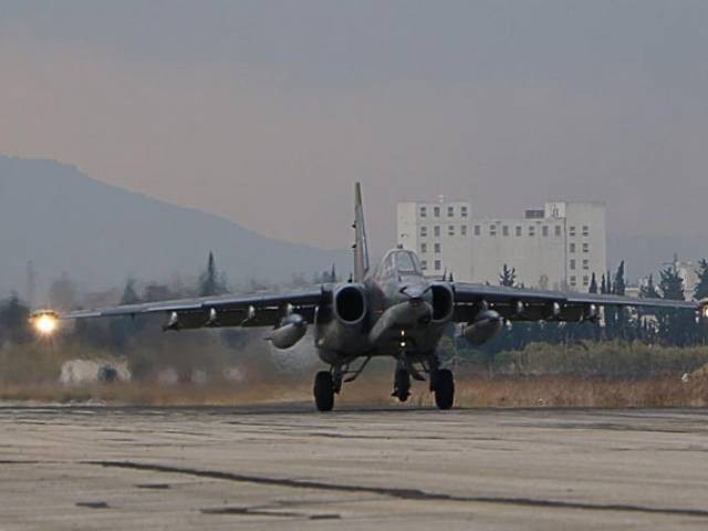 A Russian Sukhoi Su-34 bomber lands at the Russian Hmeimim military base in Latakia province, in the northwest of Syria, on December 16, 2015. PHOTO: AFP
