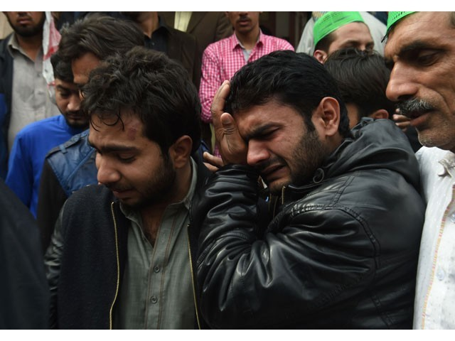 Relatives mourn the death of a blast victim during a funeral ceremony in Lahore on February 14, 2017. PHOTO: AFP
