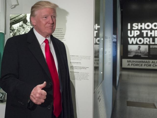 US President Donald Trump gives a thumbs-up as he tours the Smithsonian National Museum of African American History and Culture in Washington, DC, February 21, 2017. PHOTO: AFP