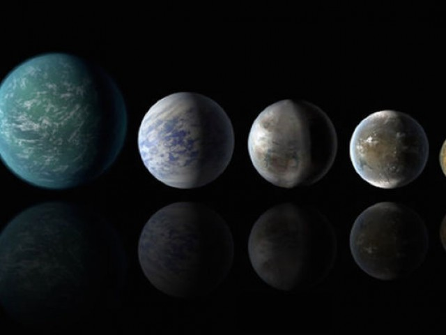 A picture of Earth and artist's interpretations of several exoplanets that could be like our own. From left: artist's impressions of Kepler-22b, Kepler-69c, Kepler-452b, Kepler-62f and Kepler-186f. A picture of Earth is at far right. PHOTO: NASA