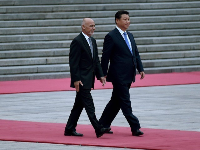 Afghan President Ashraf Ghani with Chinese President Xi Jinping. PHOTO: REUTERS