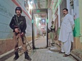 A police man stands guard outside the Hindu Dargah in Peshawar. PHOTO: MUHAMMAD IQBAL/EXPRESS