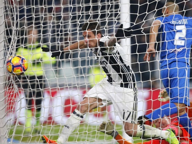 Ushering it home: Mandzukic opened the scoring for Juventus in what proved to be a tricky outing for the runaway leaders against Empoli. PHOTO: AFP