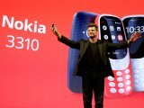 Arto Nummela, CEO of Nokia-HMD, holds up a Nokia 3310 device during a presentation ceremony at Mobile World Congress in Barcelona, Spain, February 26, 2017. PHOTO: AFP