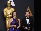 "Orlando von Einsiedel and Joanna Natasegara hold their Oscars for Best Documentary Short Subject for ""The White Helmets"".  PHOTO: REUTERS"