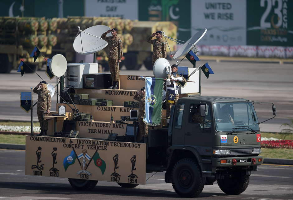 Military personnel salute as they take part in a Pakistan Day military parade in Islamabad. PHOTO: AFP