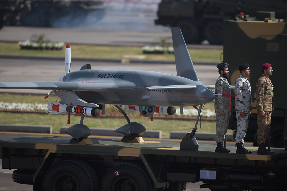 Military personnel stand beside a drone on a transporter during a Pakistan Day military parade in Islamabad. PHOTO: AFP