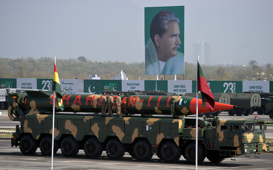 Military personnel stand beside a Shaheen III surface-to-surface ballistic missile during a Pakistan Day military parade in Islamabad. PHOTO: AFP