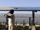a-worker-cleans-photovoltaic-solar-panels-inside-a-solar-power-plant-at-raisan-village-near-gandhinagar-2-2