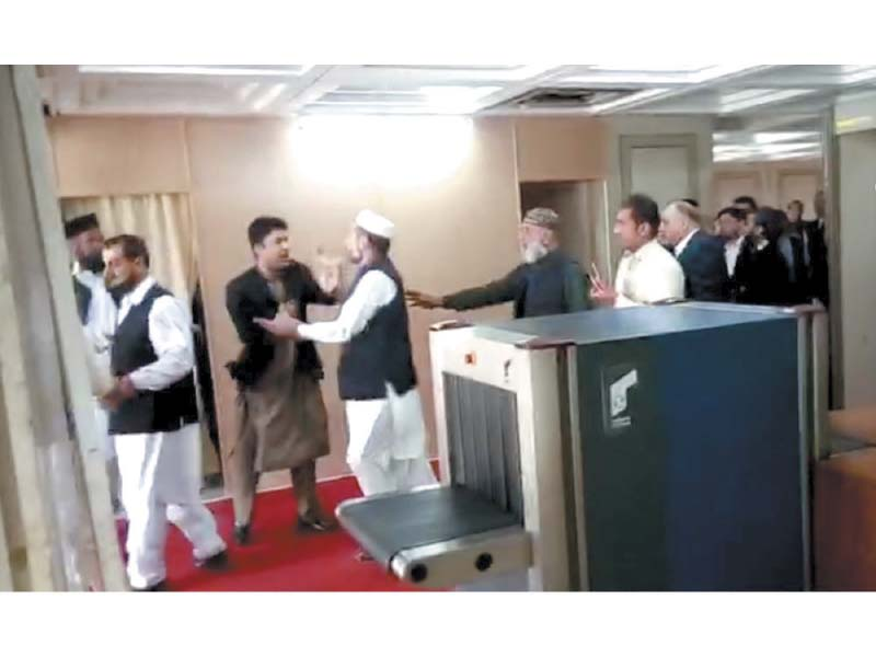 Fellow MPs try to stop PTI's Murad Saeed during a scuffle with PML-N's Javed Latif. PHOTO: INP