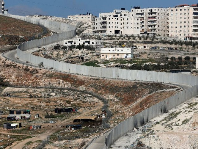 Israel's separation barrier dividing east Jerusalem from the West Bank village of Anata