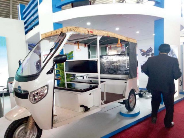 An electronic, solar-powered rickshaw Rick-E is on display. PHOTO: EXPRESS