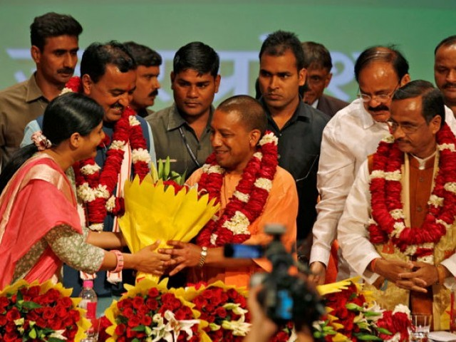 Yogi Adityanath (C) is greeted after he was elected as Chief Minister of India's most populous state of Uttar Pradesh, during the party lawmakers' meeting in Lucknow, India March 18, 2017. PHOTO: REUTERS