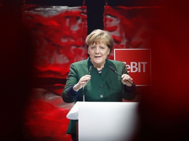 German Chancellor Angela Merkel delivers her speech. PHOTO: AFP