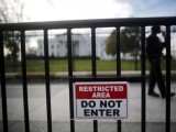 a-restricted-area-sign-is-seen-outside-of-the-white-house-in-washington-2