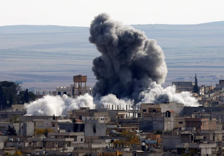 A file photo of an explosion following an air strike is seen in western Kobani neighbourhood, November 23, 2014. PHOTO: REUTERS