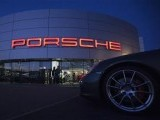 An illuminated Porsche logo is pictured on a building of a Porsche retail centre in Niederwangen. PHOTO: REUTERS