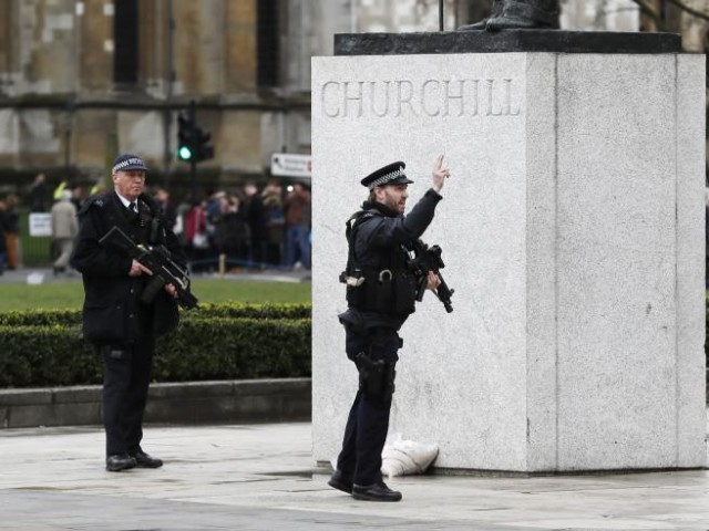 Armed police respond outside Parliament during an incident on Westminster Bridge. PHOTO: REUTERS