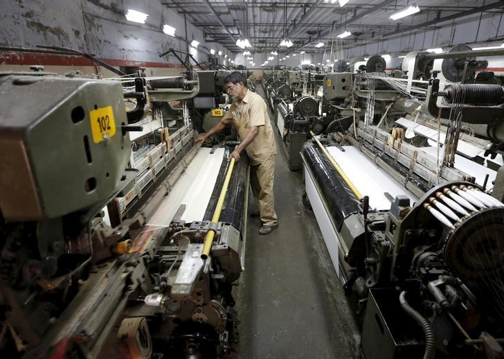 an-employee-works-at-the-production-line-of-a-textile-mill-on-the-outskirts-of-ahmedabad-2