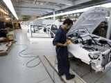 a-man-works-in-an-assembly-line-of-hyundai-cars-in-egypts-biggest-car-assembler-gb-auto-in-cairo