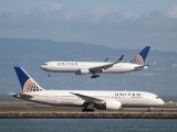 A United Airlines Boeing 787 taxis as a United Airlines Boeing 767 lands at San Francisco International Airport. PHOTO: REUTERS
