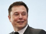 tesla-chief-executive-elon-musk-smiles-as-he-attends-a-forum-on-startups-in-hong-kong-3