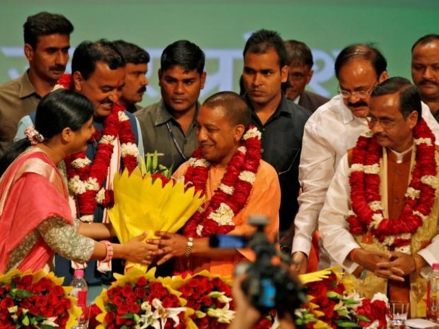 India's ruling Bharatiya Janata Party (BJP) leader Yogi Adityanath (C) is greeted after he was elected as Chief Minister of India's most populous state of Uttar Pradesh, during the party lawmakers' meeting in Lucknow, India March 18, 2017. PHOTO: REUTERS