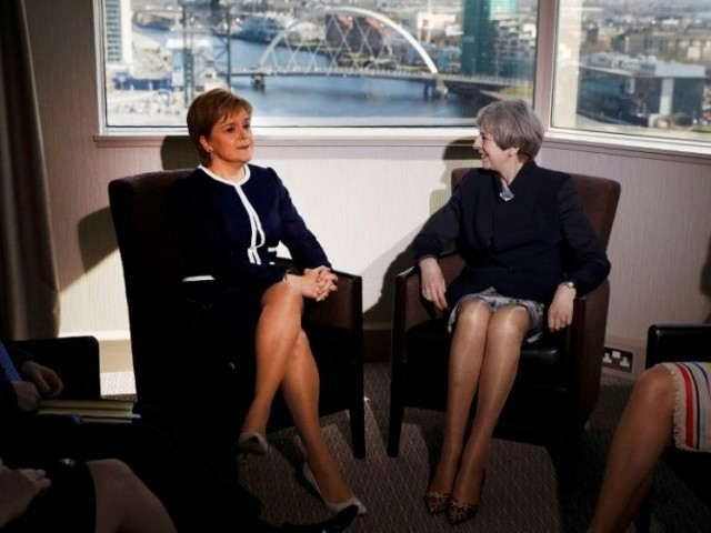 Britain's Prime Minister Theresa May (R) and Scotland's First Minister Nicola Sturgeon pose ahead of their meeting in a Glasgow hotel on Monday, but their talks failed to bridge the divide over Scottish independence. PHOTO: AFP
