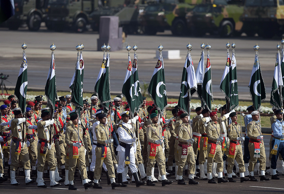 Pakistani forces soldiers march past during a Pakistan Day military parade in Islamabad. PHOTO: AFP