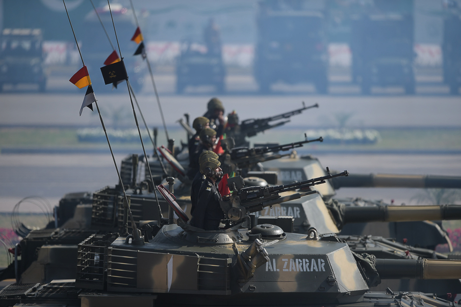 Tank crews steer their vehicles during a Pakistan Day military parade in Islamabad. PHOTO: AFP