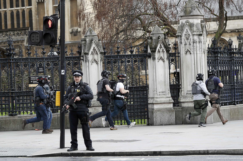 Armed police respond outside Parliament during the incident. PHOTO: REUTERS