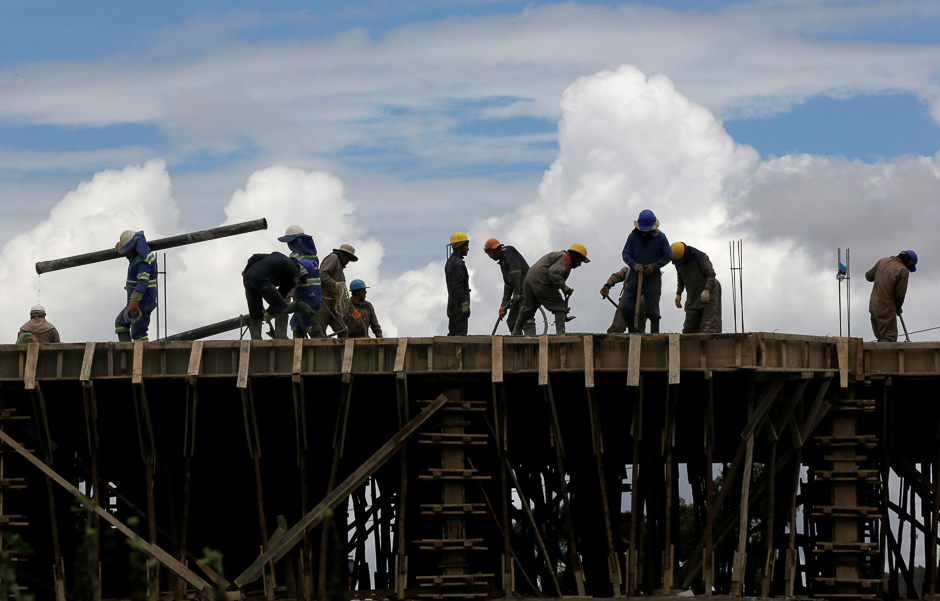 People work on the construction of a building in La Paz, Bolivia. PHOTO: REUTERS