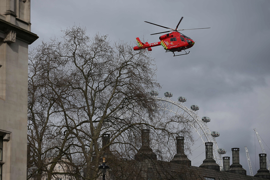 An air ambulance flies above Portcullis House, next to the Houses of Parliament in central London. PHOTO: AFP