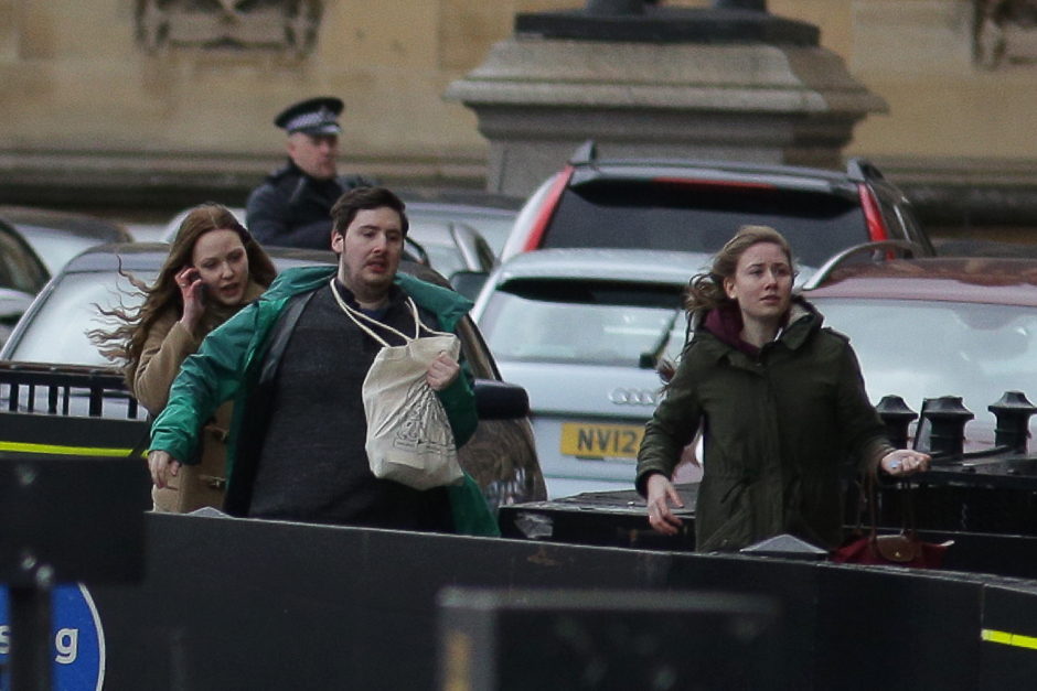 People leave after being evacuated from the Houses of Parliament in central London. PHOTO: REUTERS