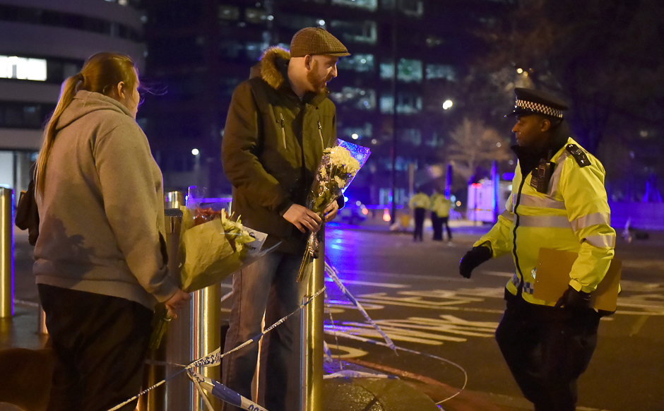 People leave flowers at the scene after an attack on Westminster Bridge in London, Britain. PHOTO: REUTERS